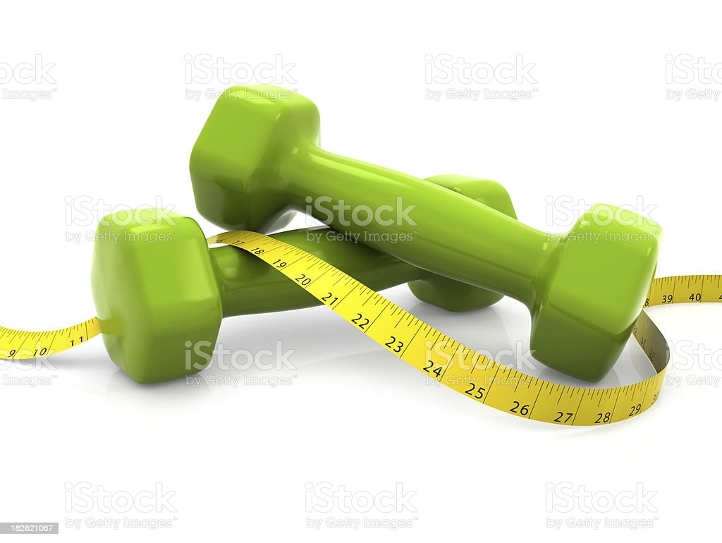 Dumbells with measure (inch) royalty-free stock photo