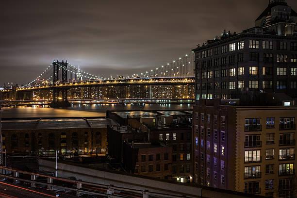 Dumbo and Manhatan Bridge at night stock photo