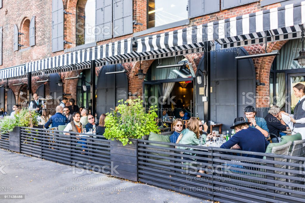 Dumbo outside exterior outdoors in NYC New York City, people sitting eating in Italian restaurant Cecconis stock photo