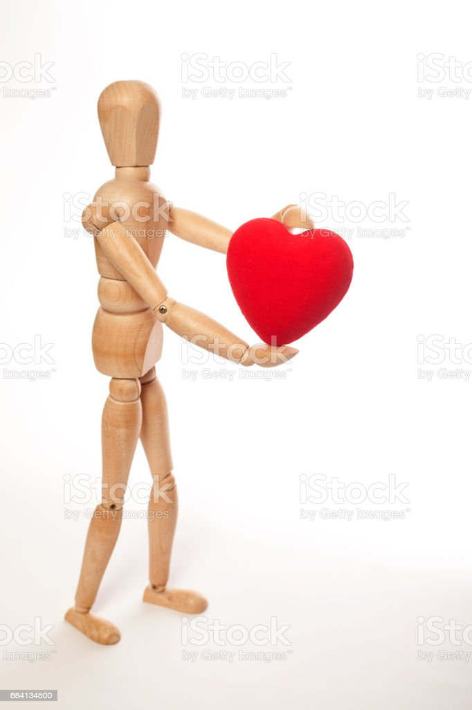 Dummy and red heart royalty free stockfoto