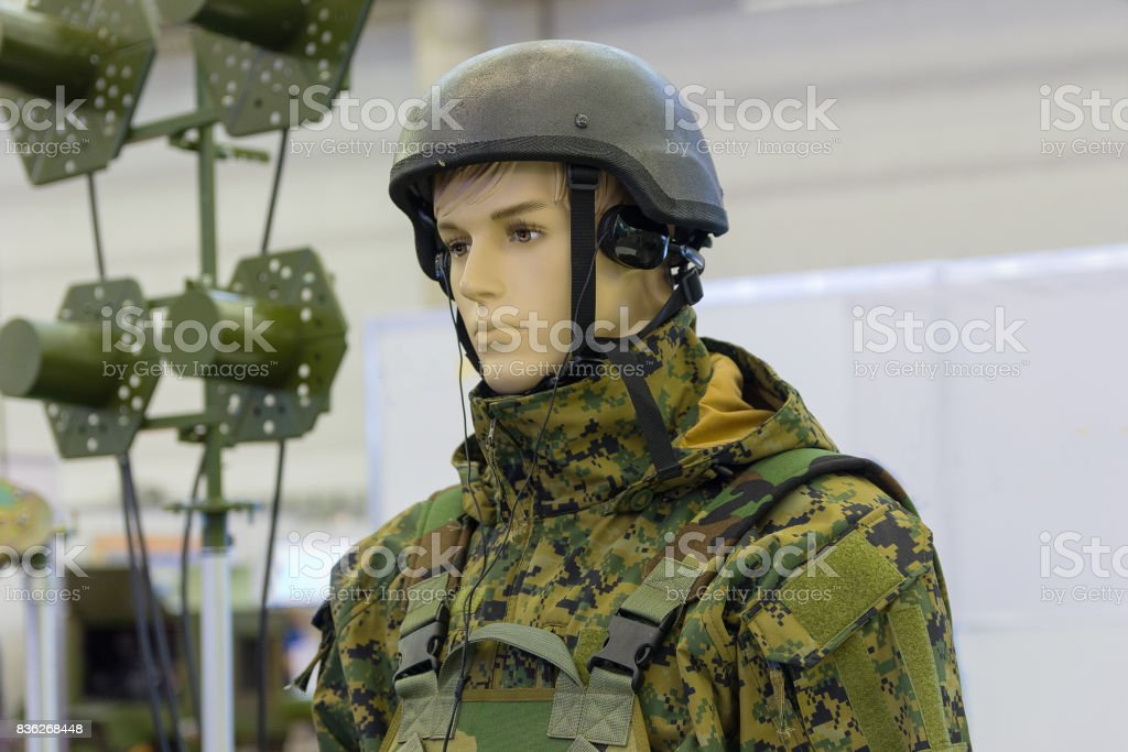 Dummy in army helmet with headphones. Armament stock photo