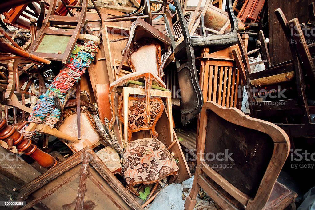 Dump old wooden chairs chairs, one on the other stock photo