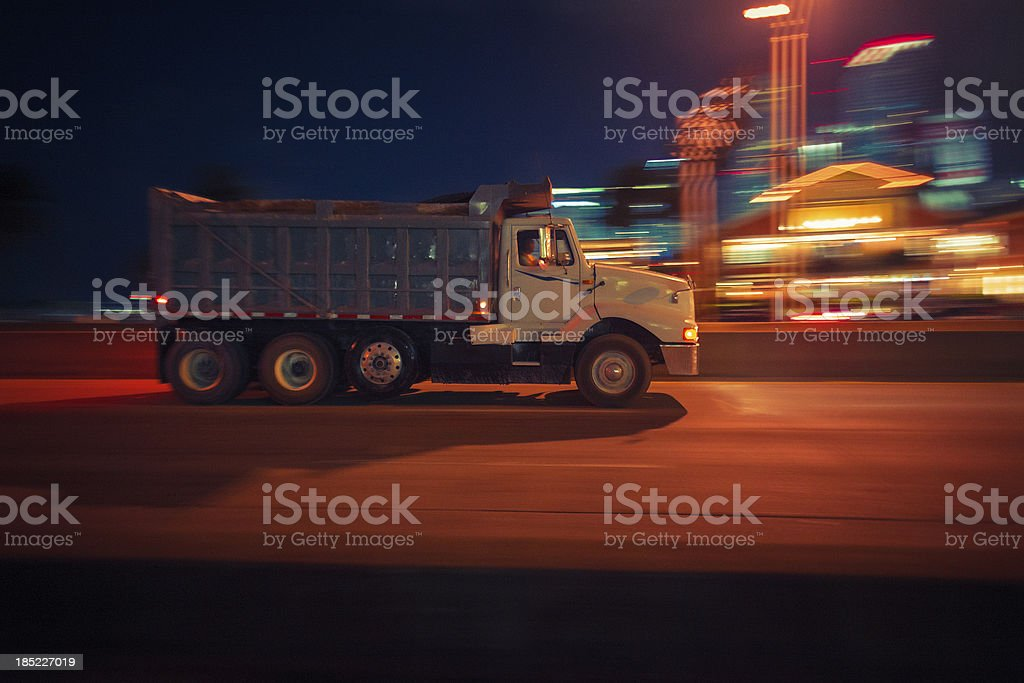 dump truck at night stock photo