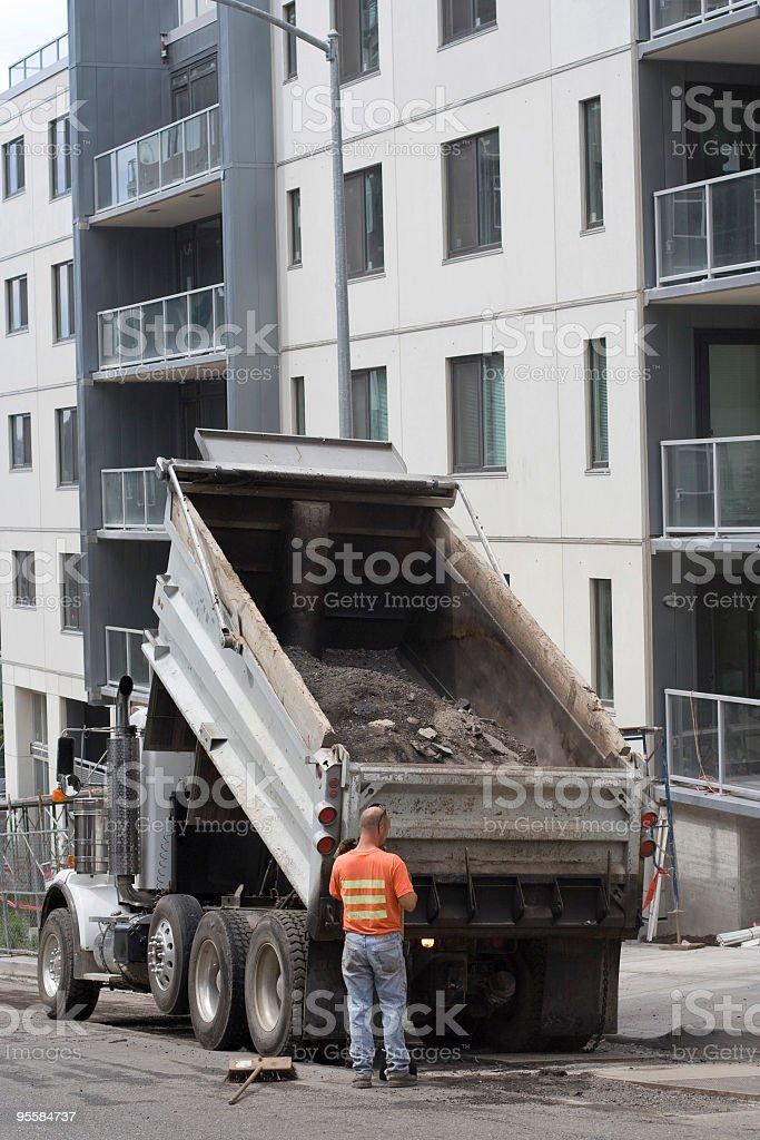 Dump truck backing up stock photo