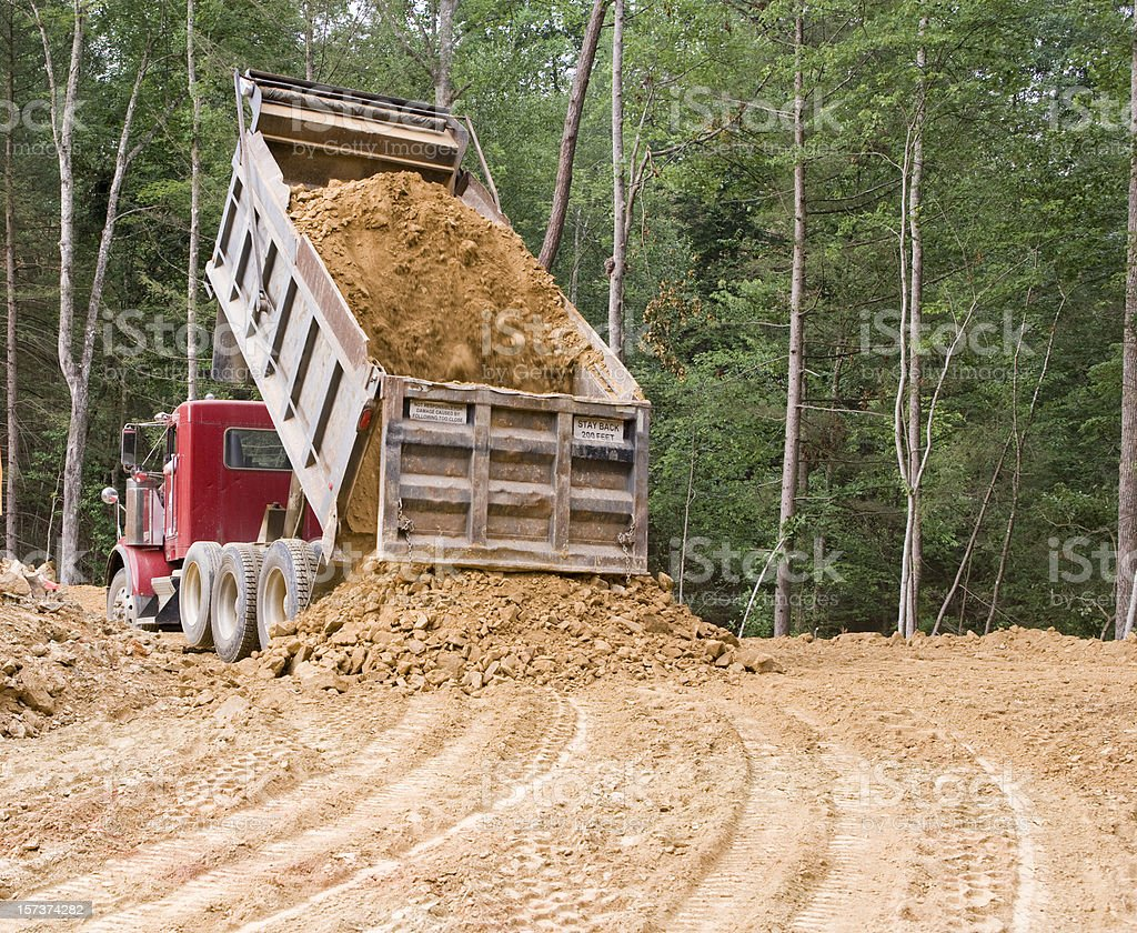 Dump truck dumping stock photo