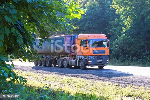 istock dump truck goes on country highway 507638682