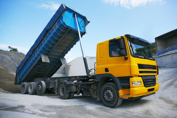 dump truck in a quarry - lorries unloading stock photos and pictures