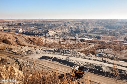 istock Dump truck moving by the road to coal mine 964276426