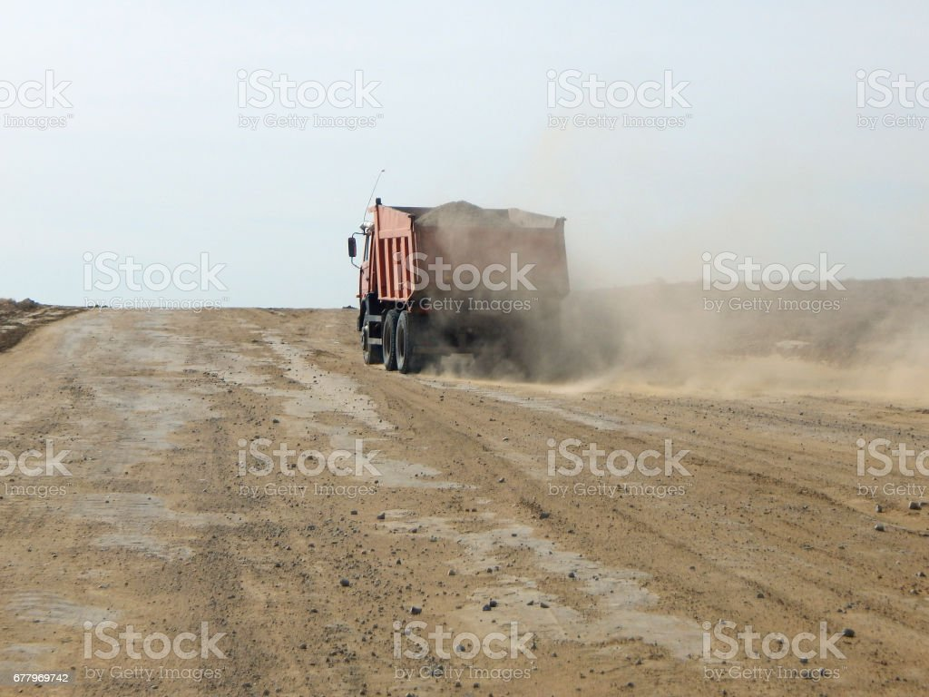 Dump truck on a dirt road. royalty-free stock photo