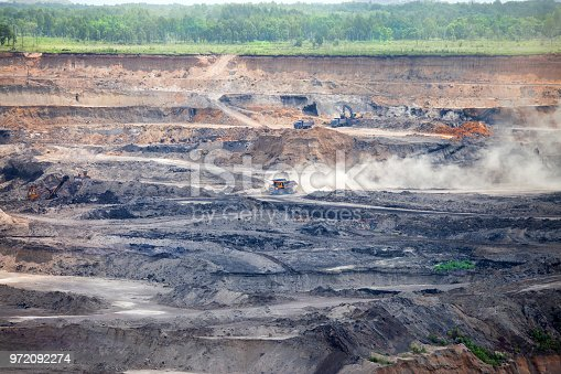 istock Dump trucks at open coal mine 972092274