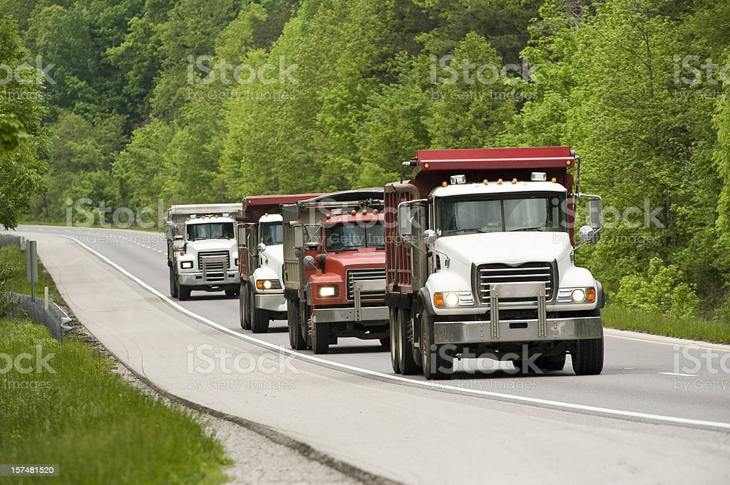 Dump Trucks On Highway stock photo