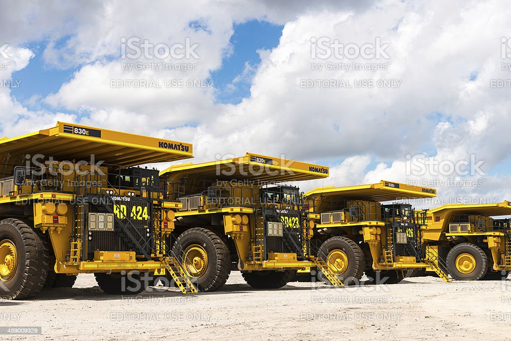 Dump Trucks Parked up due to recession stock photo