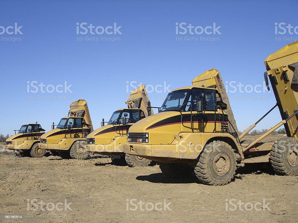 Dump trucks ready for work royalty-free stock photo