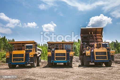 istock Dump trucks ready to work 1060887514