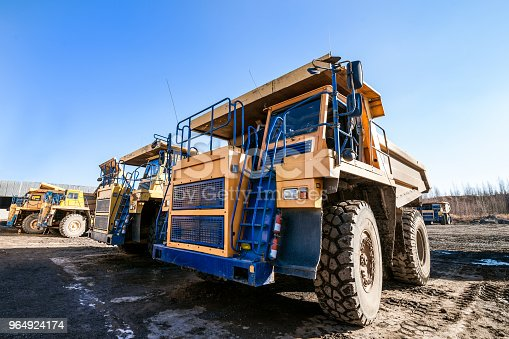 istock Dump trucks ready to work 964924174