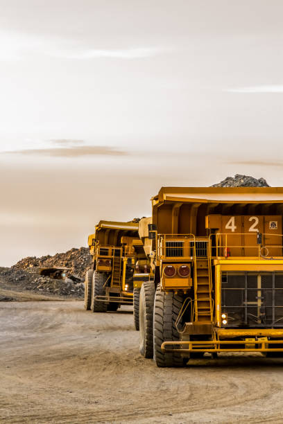 Dump Trucks transporting Platinum ore for processing Platinum and Palladium Mining and processing, Dump Truck for transporting rocks mining natural resources stock pictures, royalty-free photos & images