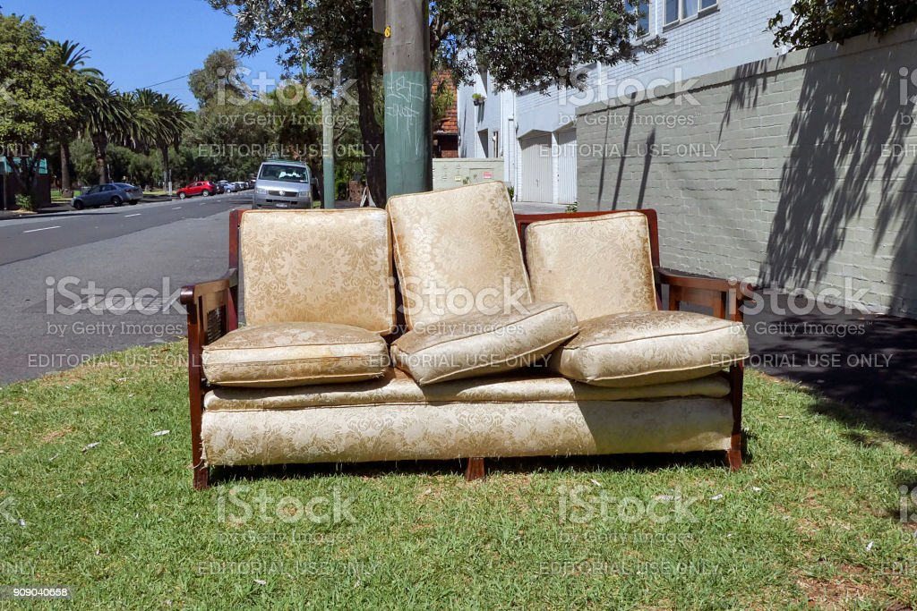 Dumped lounge suite in a residential area. stock photo