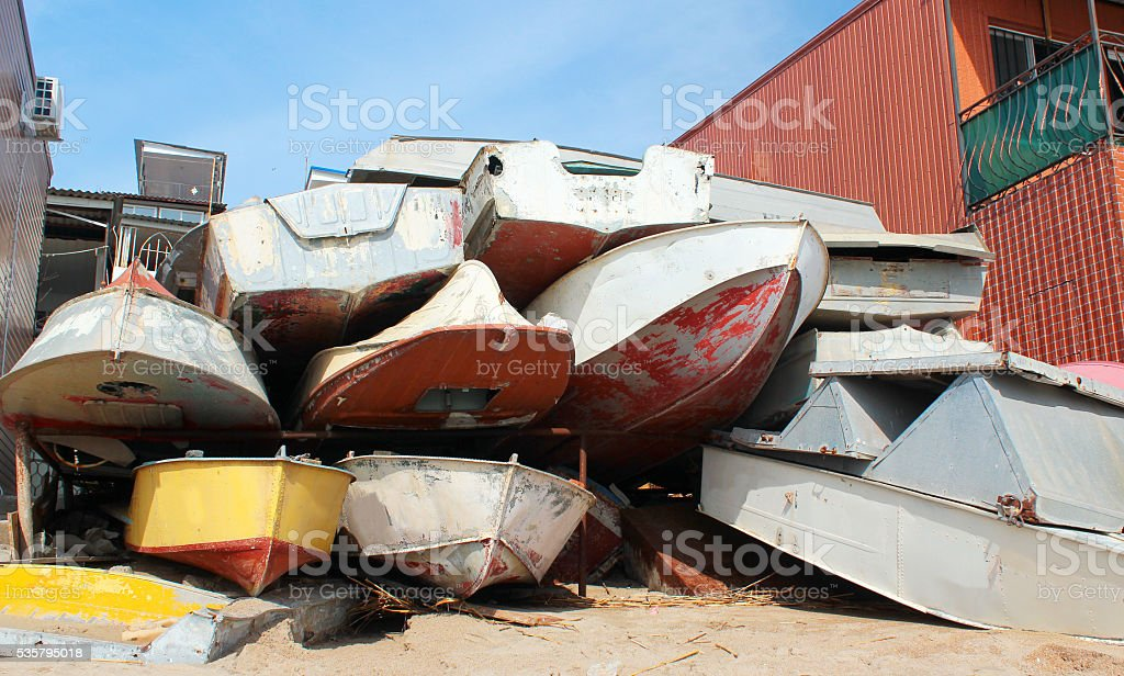 Dumped old motorboats stock photo