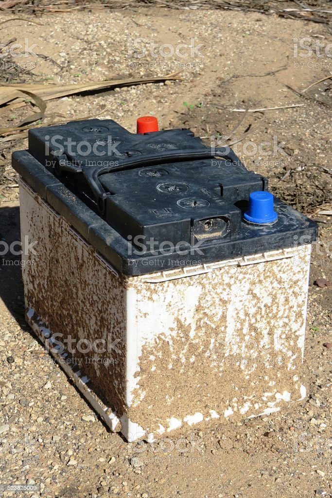 Dumped used car battery stock photo