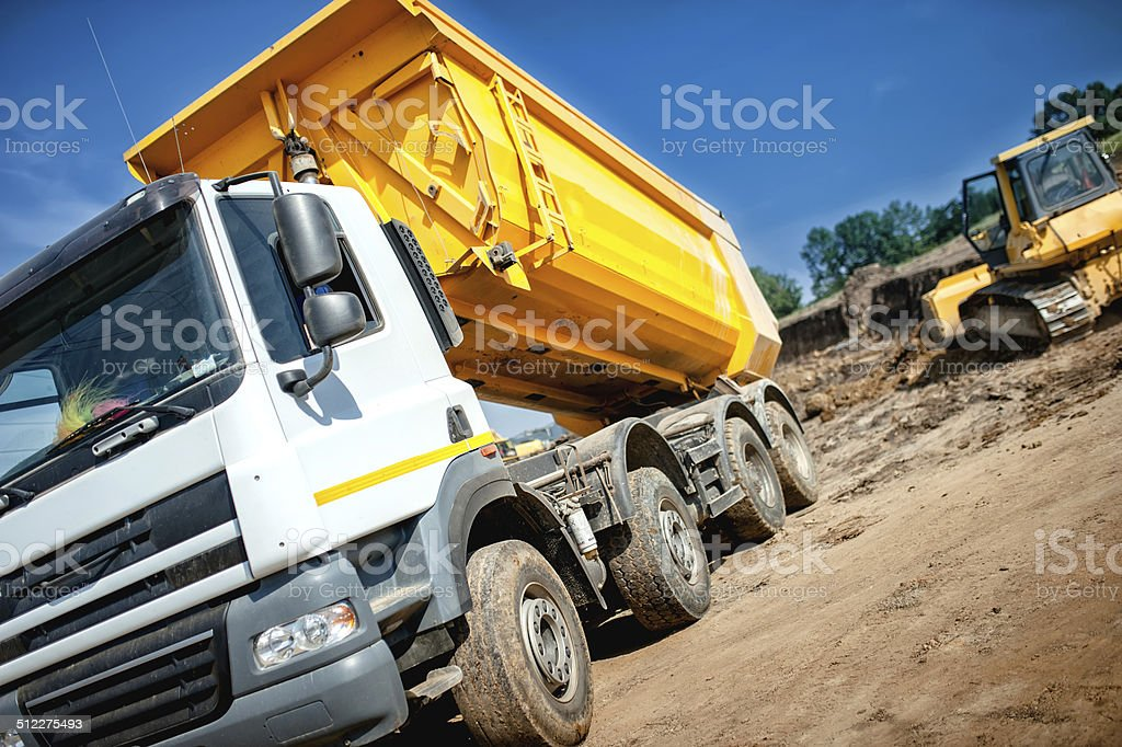 dumper truck at industrial constrution site waiting for earth load stock photo