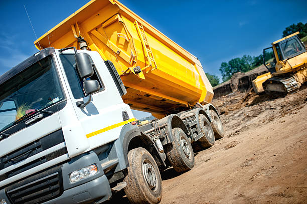 dumper truck at industrial constrution site waiting for earth load - grind stockfoto's en -beelden