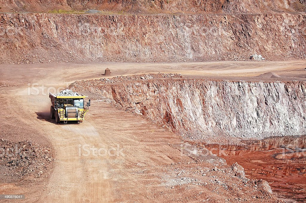 dumper truck on road in surface mine quarry stock photo