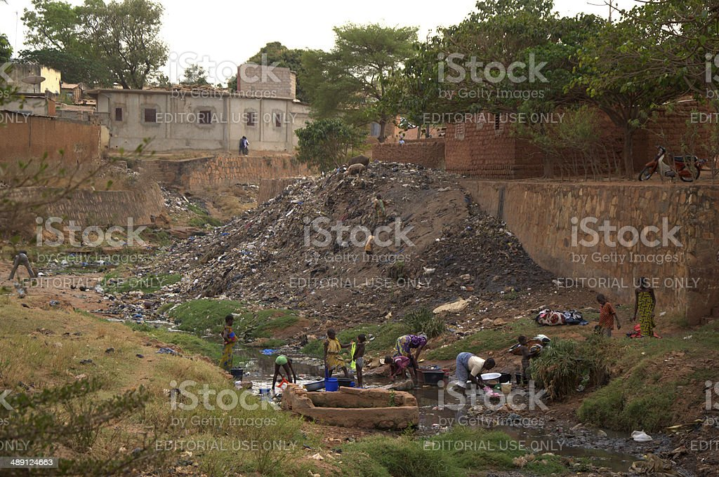 dumping ground in a riverbed in Burkina Faso stock photo