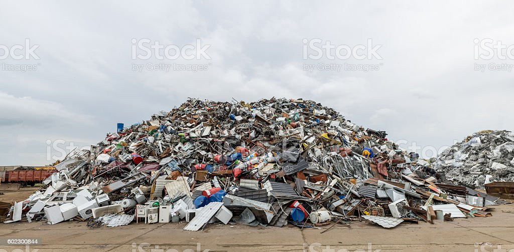 Dumping ground. Scrap metal heap. Compressed crushed cars for recycling stock photo