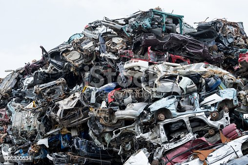 istock Dumping ground. Scrap metal heap. Compressed crushed cars is returned 602300534