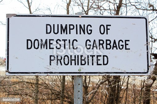 istock Dumping of domestic garbage prohibited sign 666856098