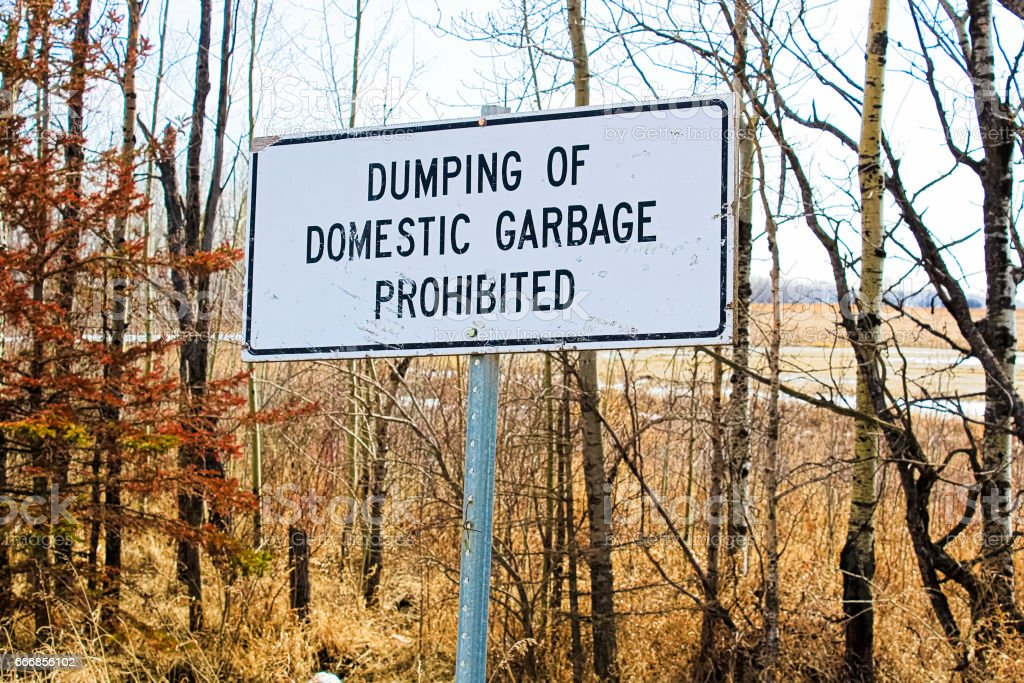 Dumping of domestic garbage prohibited sign stock photo