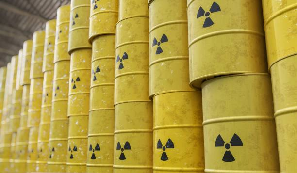 Dumping of radioactive waste barrels. 3D rendered illustration. stock photo