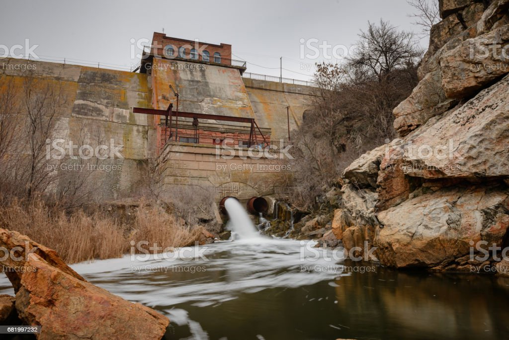 Dumping of water on a river dam stock photo