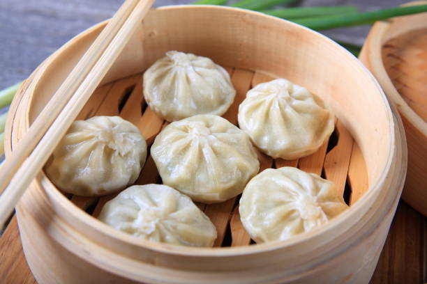 Dumplings in a bamboo steamer stock photo
