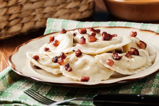 dumplings with meat or cabbage and mushroom or cheese seasoned fried bacon - eastern european culture stock photos and pictures
