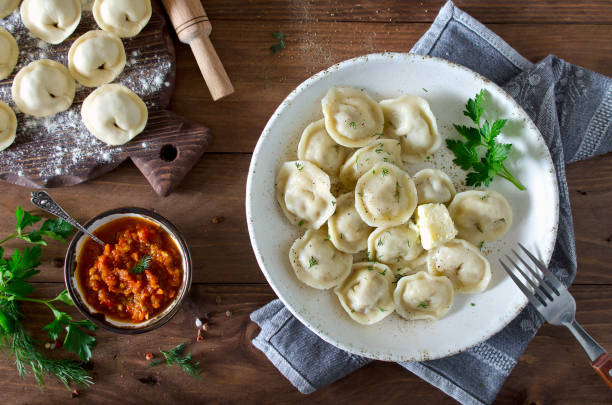 dumplings with meat, spiced with pepper and dill - dumplings stock photos and pictures