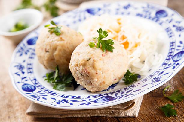 dumplings with sauerkraut - semmelknödel stock-fotos und bilder