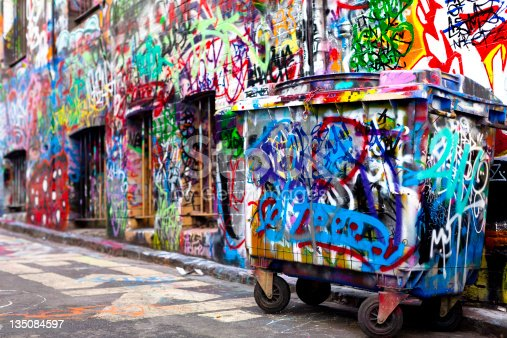 534781401 istock photo Dumpster and wall covered with colorful graffiti 135084597
