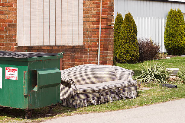 Dumpster Couch stock photo