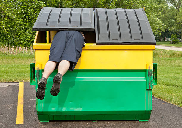 dumpster diver stock photo