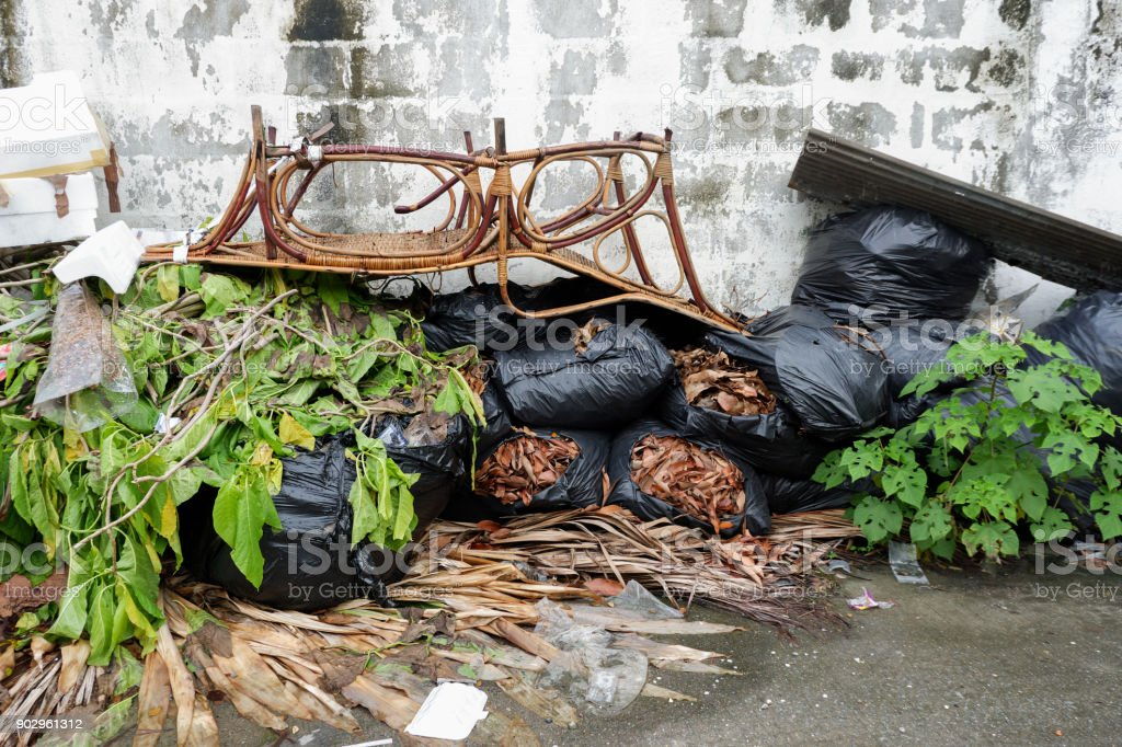 Dumpsters being full with garbage after the rain stock photo
