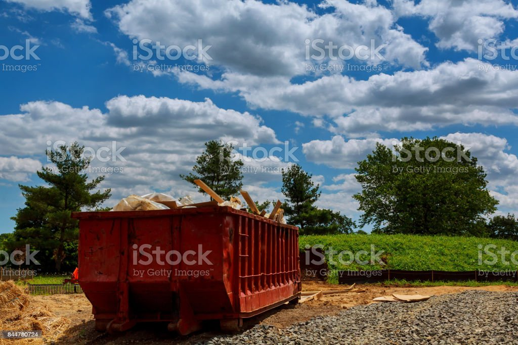 Dumpsters being full with garbage in a city. stock photo