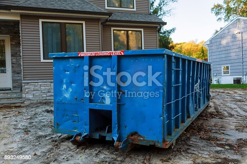 istock Dumpsters being full with garbage in a city. 893249580