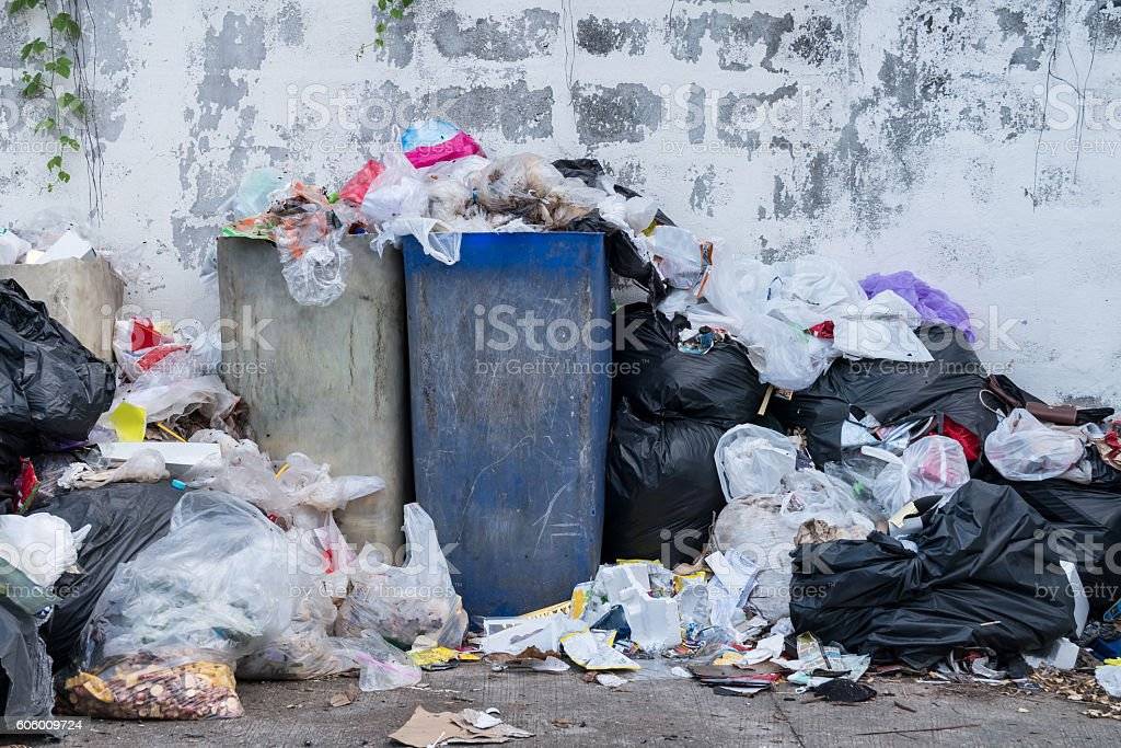 Dumpsters being full with garbage in the evening stock photo