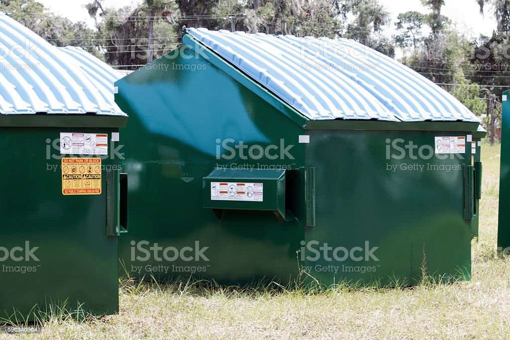Dumpsters With Lids and Stickers royalty-free stock photo