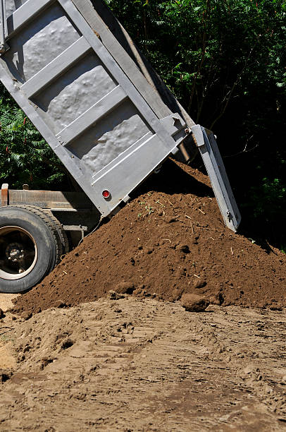 dumptruck with loam pile - mike cherim stock pictures, royalty-free photos & images