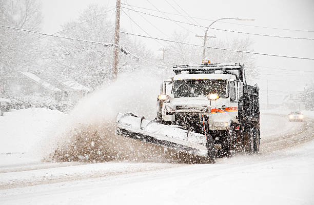 dumptruck with plow plowing snow during northeaster - blizzard stock photos and pictures