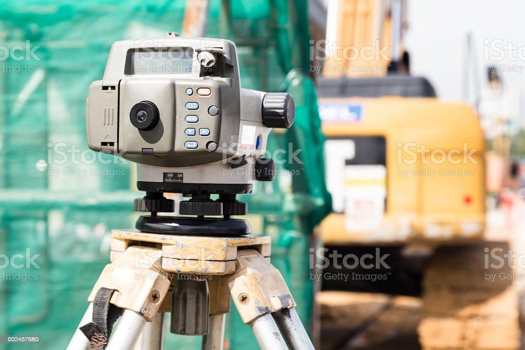 Dumpy automatic level instrument with construction site backgrou stock photo