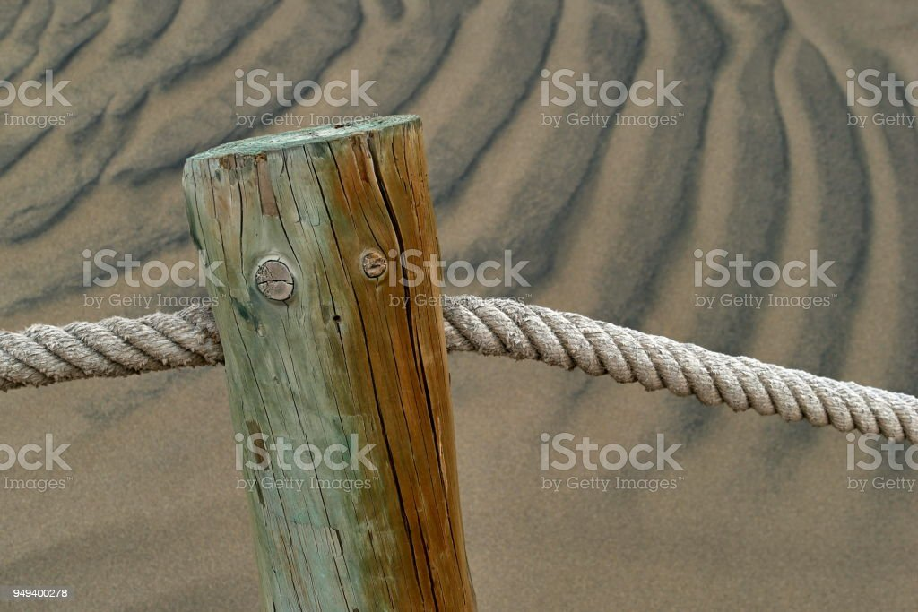 Dunas de Maspalomas - Gran Canaria at storm - with wooden poles stock photo