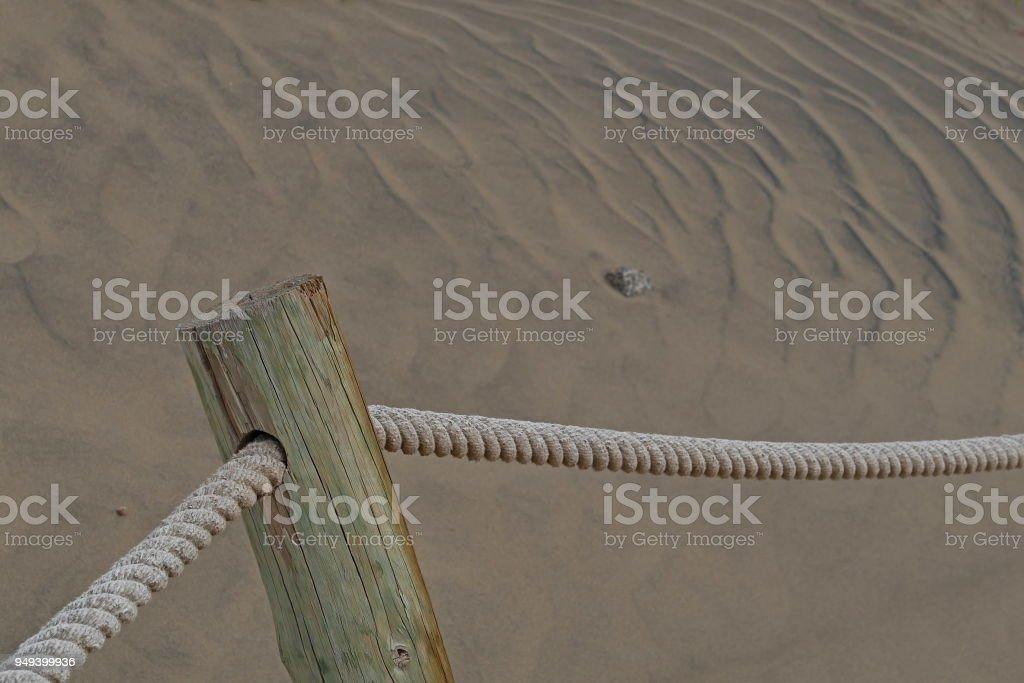 Dunas de Maspalomas - Gran Canaria at storm - with wooden poles_3 stock photo